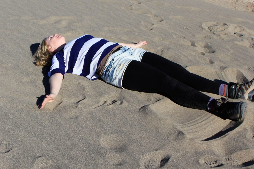 Brandy Little making a sand angel in Death Valley. Photo by Barbara Little.