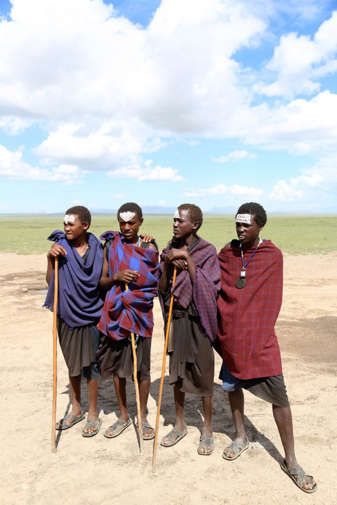 Masai tribesmen garbed in shukas. Photo by Brandy Little